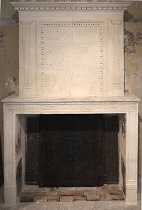 antique stone fireplace dating from the 18th century